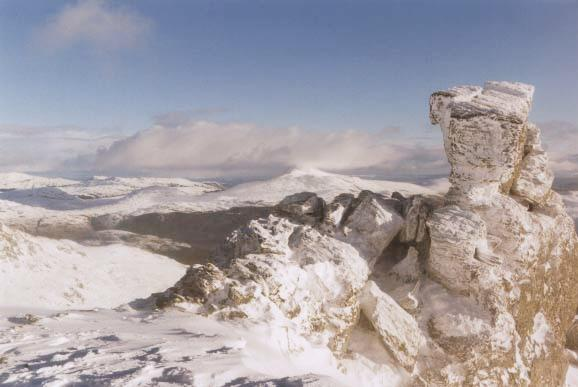 The summit rocks, with Ben Lomond disappearing into the